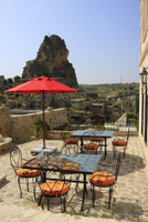 Outdoor tables - View on Cappadocia old rock castle